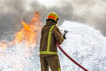 Fire fighter in action